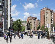 Ph. credit Martino Lombezzi. Kosovska Mitrovica (Kosovo). A view of the central square of North Mitrovica with the statue of Prince Lazar at the center.